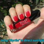 Julep nail polish in Myrtle (red) - direct sunlight